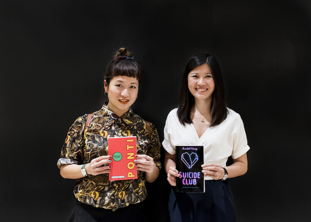 Authors Sharlene Teo and Rachel Heng posing with their debut novels Ponti and Suicide Club