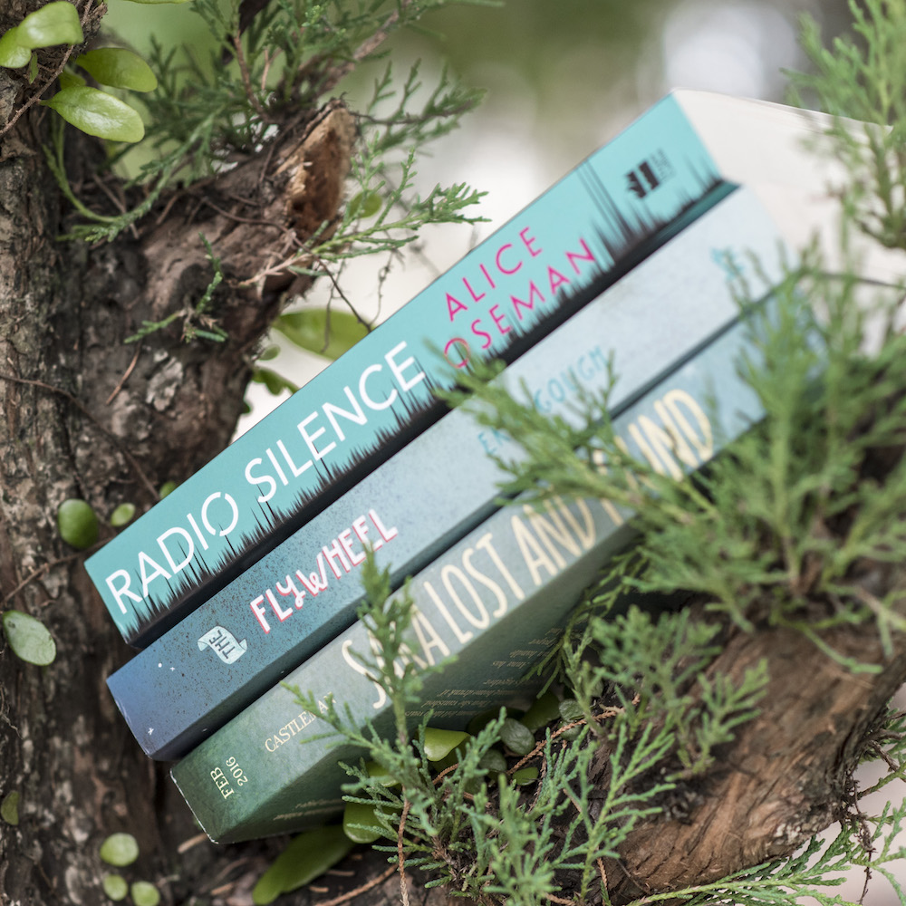 Bookish Scene: Earth Day – Mint book stack on tree branch