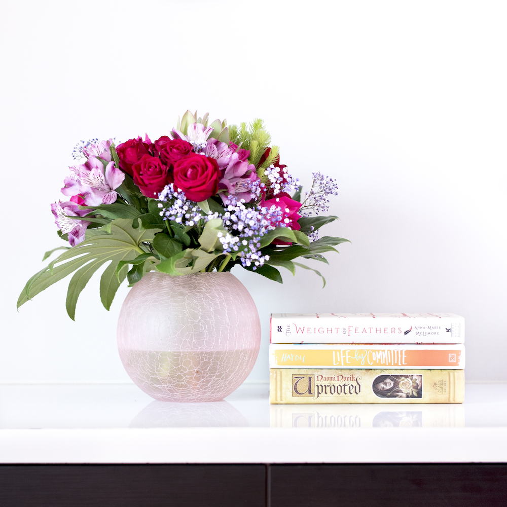 Bookish Scene: Spring – Book sick with bouquet of flowers in a vase