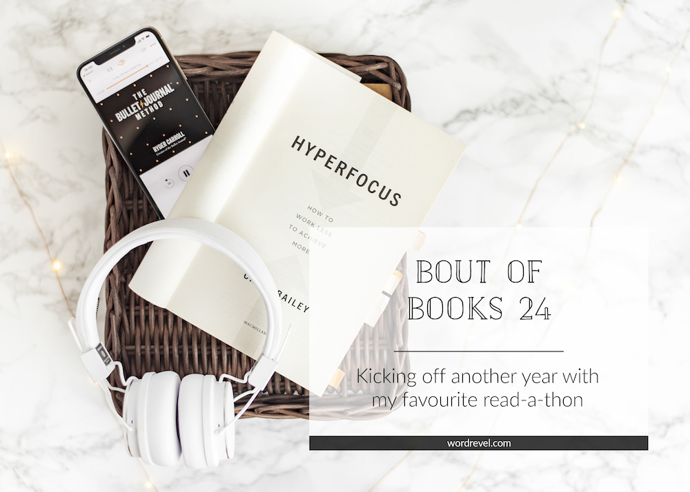 Title page of Hyperfocus and Audible audiobook of The Bullet Journal Method on iPhone with headphones