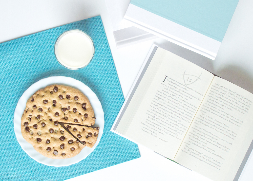 Giant chocolate chip cookie and books