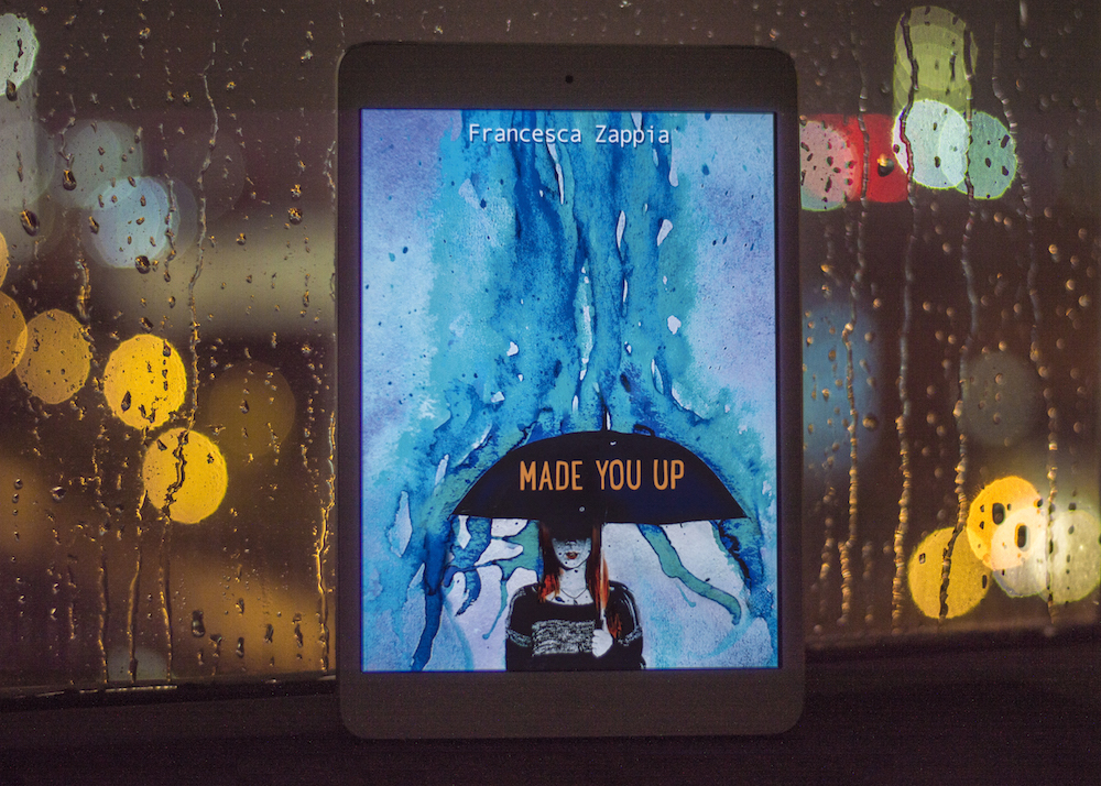 Ebook of Made You Up by Francesca Zappia in the rain
