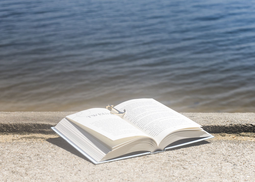 Open book with Page Anchor by the sea