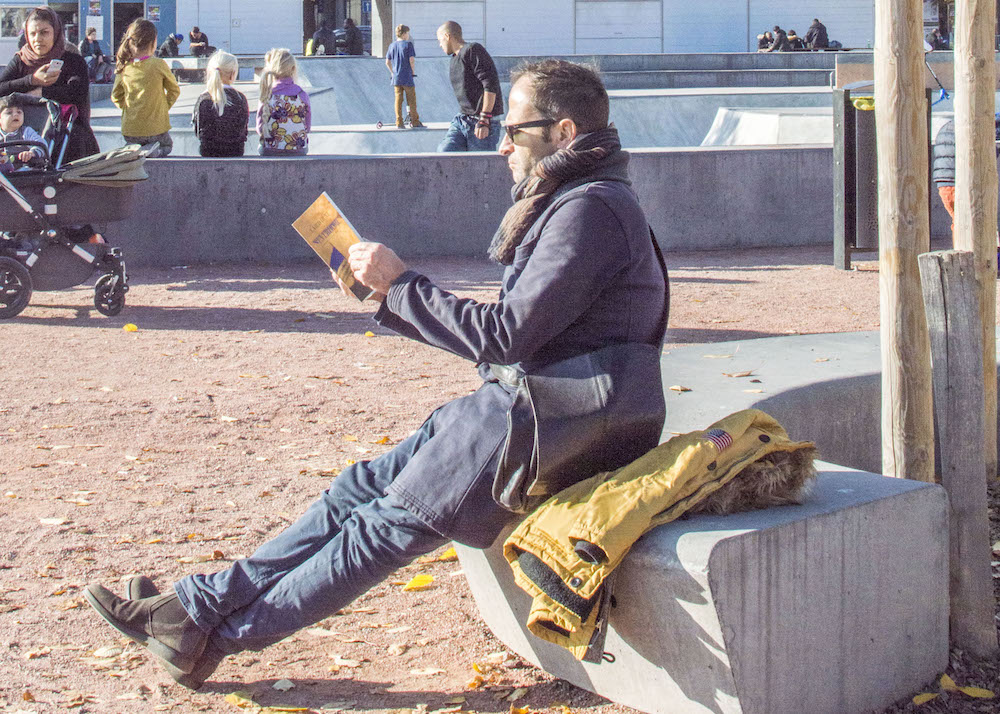 Man reading in public