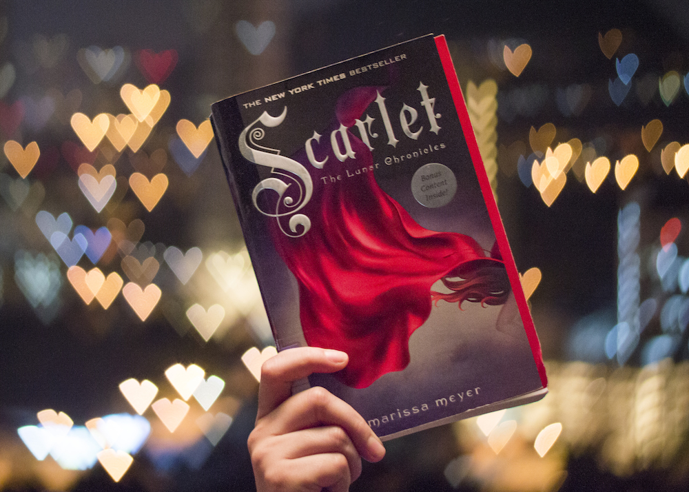 Scarlet by Marissa Meyer at night with booked hearts