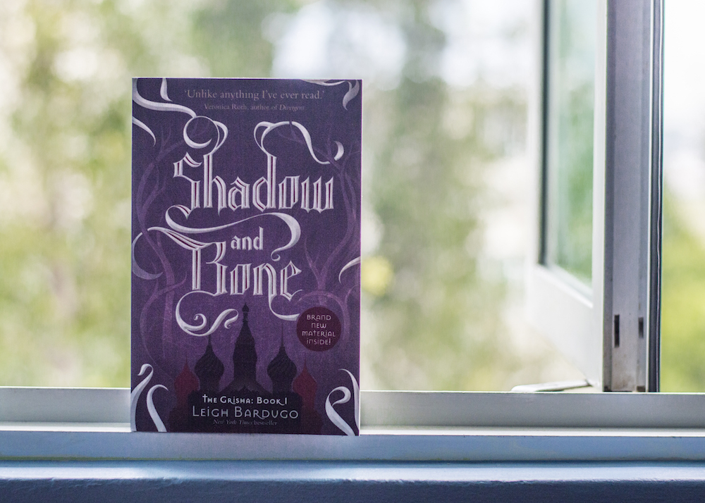 Shadow and Bone by Leigh Bardugo on a Window Ledge