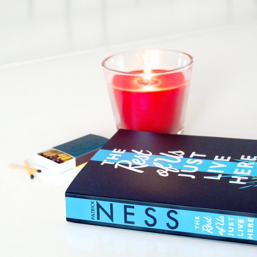The Rest of Us Just Live Here Paperback with Candle