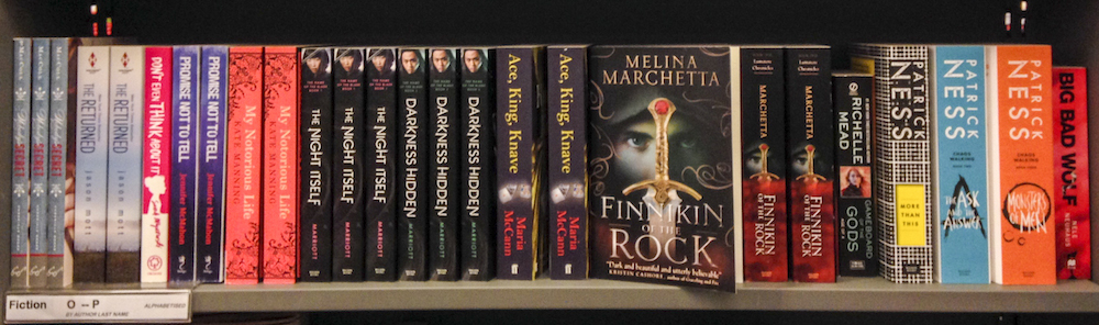 YA and general fiction mixed on bookstore shelves