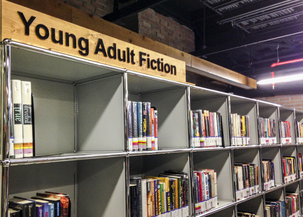 Young Adult fiction sign at library